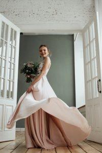 Bride standing in doorway with flowers